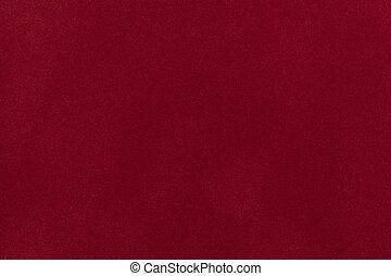 Dark red suede fabric closeup. Velvet texture.