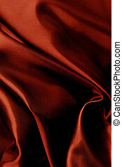 Dark red textile background.