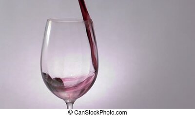 Dark red wine poured into glass