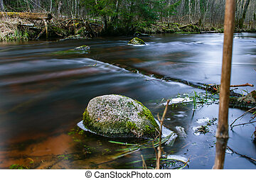 Dark river water rock