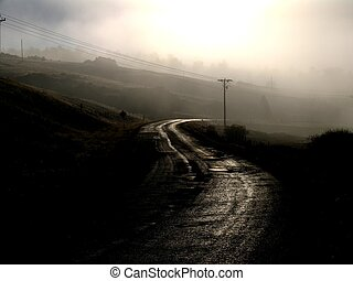 Dark road in fog.