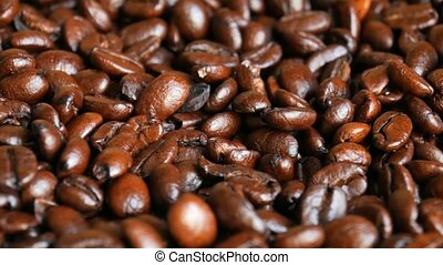 Dark roasted coffee beans - High angle macro of dark roasted...