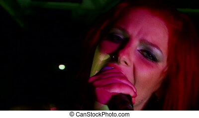 Dark rock - Beautiful girl with multicolored hair, sings...