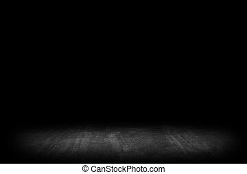 Dark room with tile floor and black background