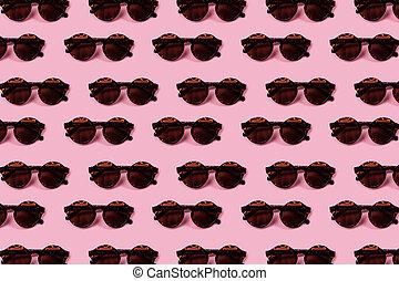 Dark round glasses in a leopard pattern