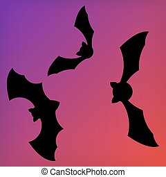 Dark silhouette of bats with open wings. One of Halloween holiday symbols on purple sunset background
