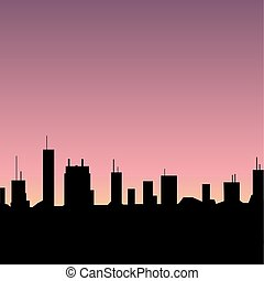 silhouette of city on sunset background