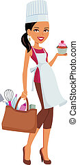 Girl with dark skin, wearing chef hat and apron and showing a cupcake she baked.