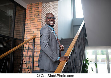 Dark-skinned businessman going to the office in the morning