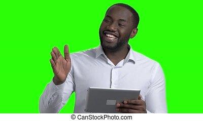 Dark-skinned businessman using digital tablet.