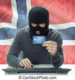 Dark-skinned hacker with flag on background holding credit card - Norway