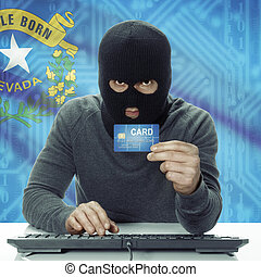 Dark-skinned hacker with credit card and USA states flag on background - Nevada