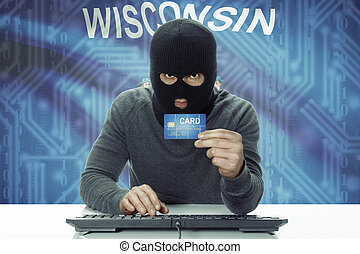 Dark-skinned hacker with USA states flag on background holding credit card - Wisconsin