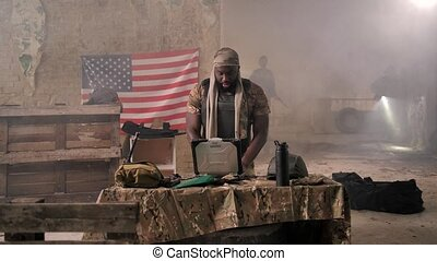 Dark-skinned soldier angry with bad news on radio - African ...