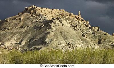Dark sky above a white hill - A steady, medium shot of the...