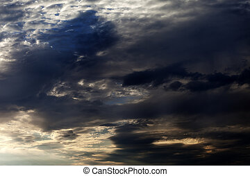 Dark sky with sunlight clouds in evening