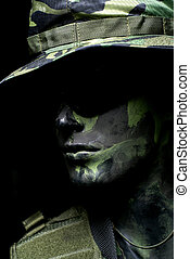 Dark soldier portrait with camouflage hat