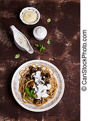 Dark spaghetti with mushrooms