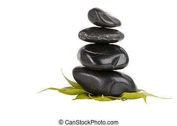 Dark stones and tree leaflets