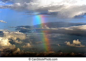 Dark Storm Clouds and Rainbow - Dark storm clouds with a...