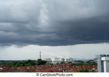 Dark storm clouds before rain in the city of Malaysia.