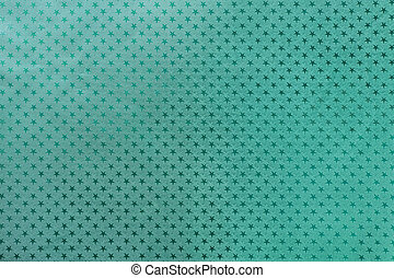 Dark turquoise background from metal foil paper with a stars pattern