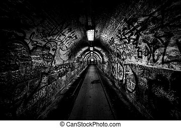 Dark undergorund passage with light