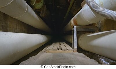 Dark underground tunnel made out of large pipes