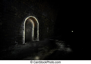 Passing place or refuge. Underground Light painting in disused railway tunnels, darkness creatively lit with torches.