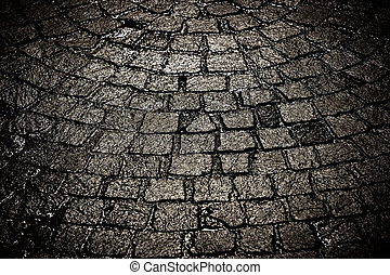 Dark wet cobblestone background tight