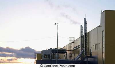 Dark-white smoke from the pipes of powerful plant