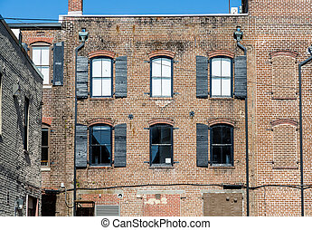 Dark Windows in Old Brick Building