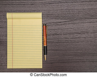 Dark Wood Desk, Yellow Pad, Pen on Desk