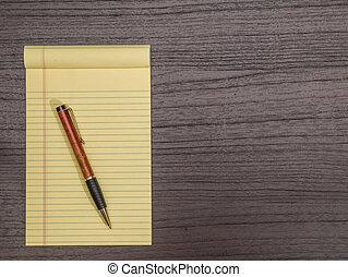 Dark Wood Desk, Yellow Pad, Pen on Pad
