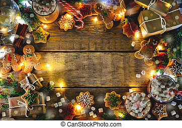 Dark wooden background with cocoa, gingerbread cookies,...