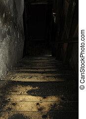 stairway - Darkstairway leads to second floor of cotton mill...