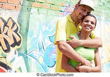 Darling - Image of young guy embracing his girlfriend on...