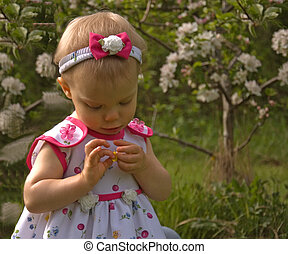 Darling Little Girl Looking At Flower