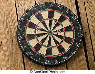 dart board on the wall