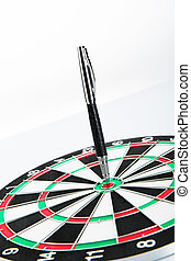 Dart board with pen on white background