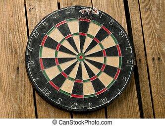 dart board with three pins