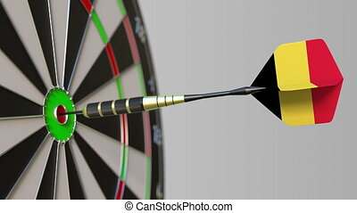 Dart featuring flag of Belgium hits bullseye of the target. Sports or political success related conceptual animation