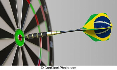 Dart featuring flag of Brazil hits bullseye of the target....