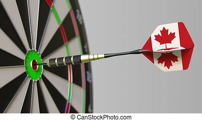 Dart featuring flag of Canada hits bullseye of the target....