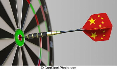 Dart featuring flag of China hits bullseye of the target....