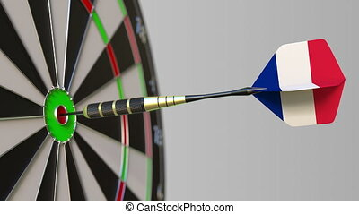 Dart featuring flag of France hits bullseye of the target....