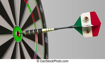 Dart featuring flag of Mexico hits bullseye of the target....