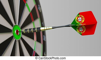 Dart featuring flag of Portugal hits bullseye of the target....