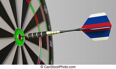Dart featuring flag of Russia hits bullseye of the target....