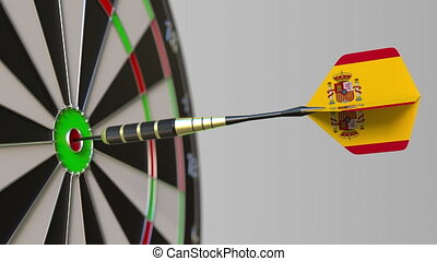 Dart featuring flag of Spain hits bullseye of the target....